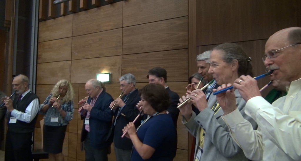ISCD Conference delegates playing tin whistle